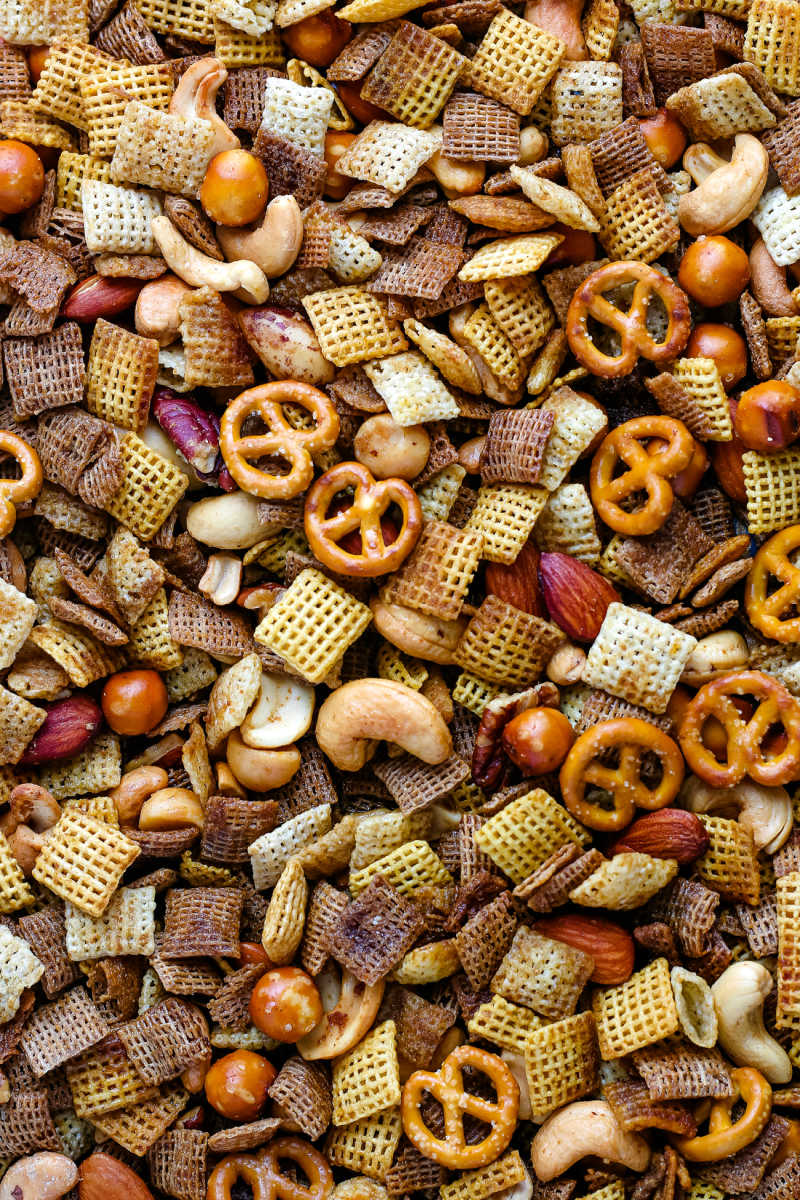 The finished Chex Party Mix on a baking sheet.