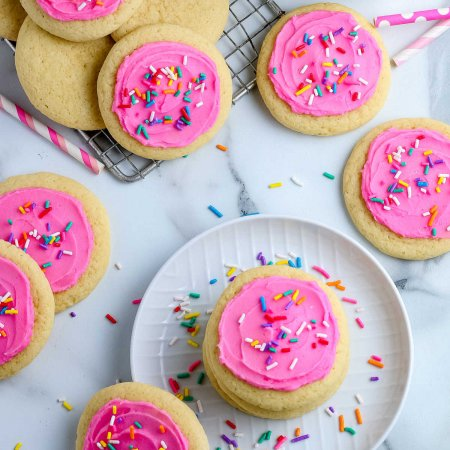 An overhead picture of Copycat Lofthouse Sugar Cookies with pink frosting and sprinkles.