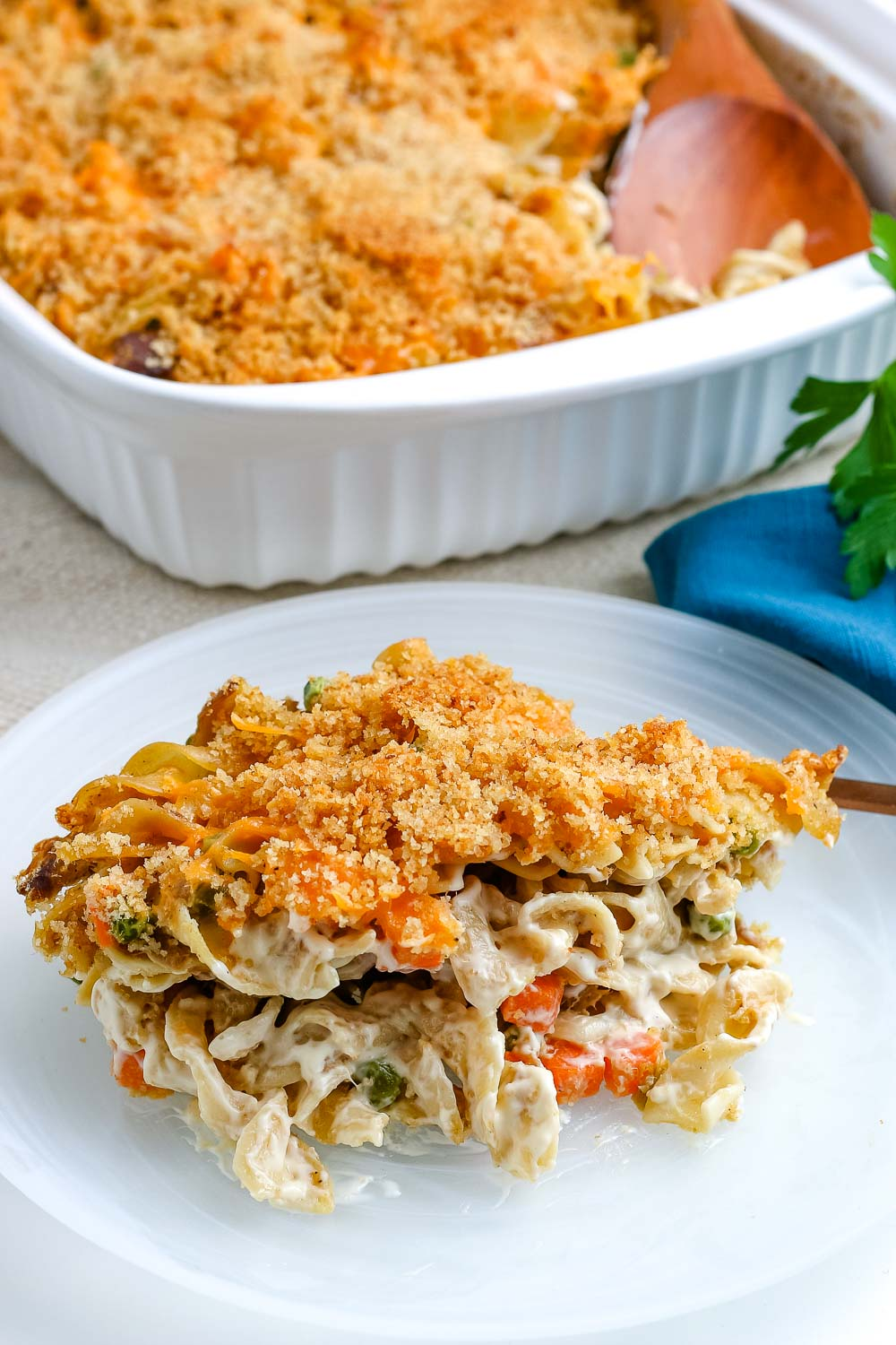 A scoop of Tuna Noodle Casserole on a white plate.