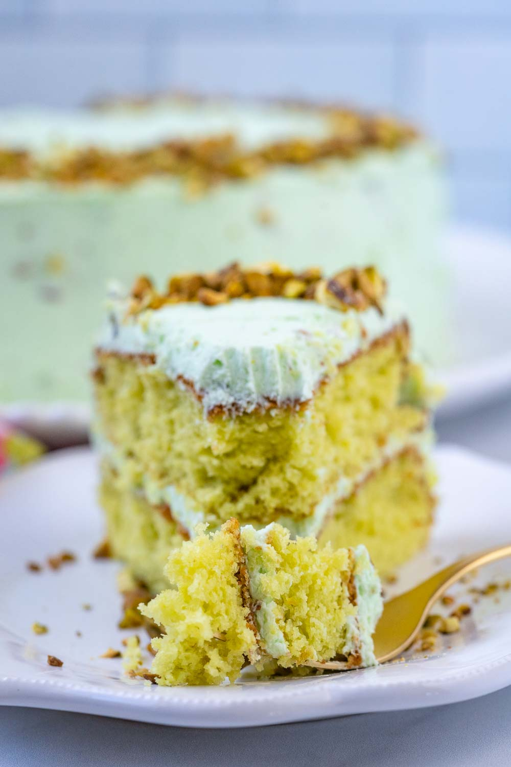 A for digging into a slice of pistachio cake.
