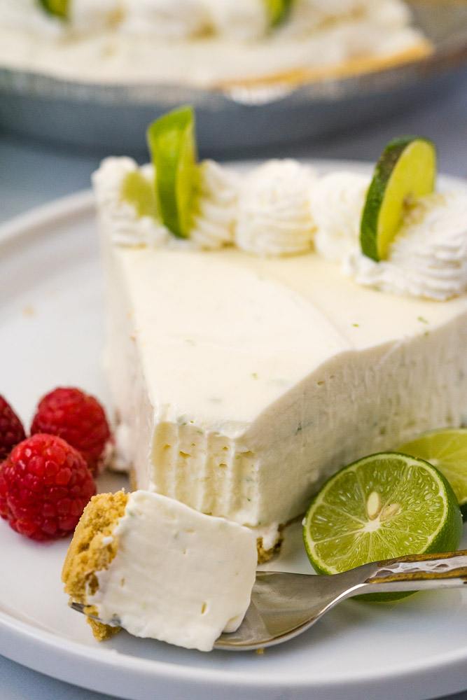 A slice of no-bake key lime pie on a white plate.