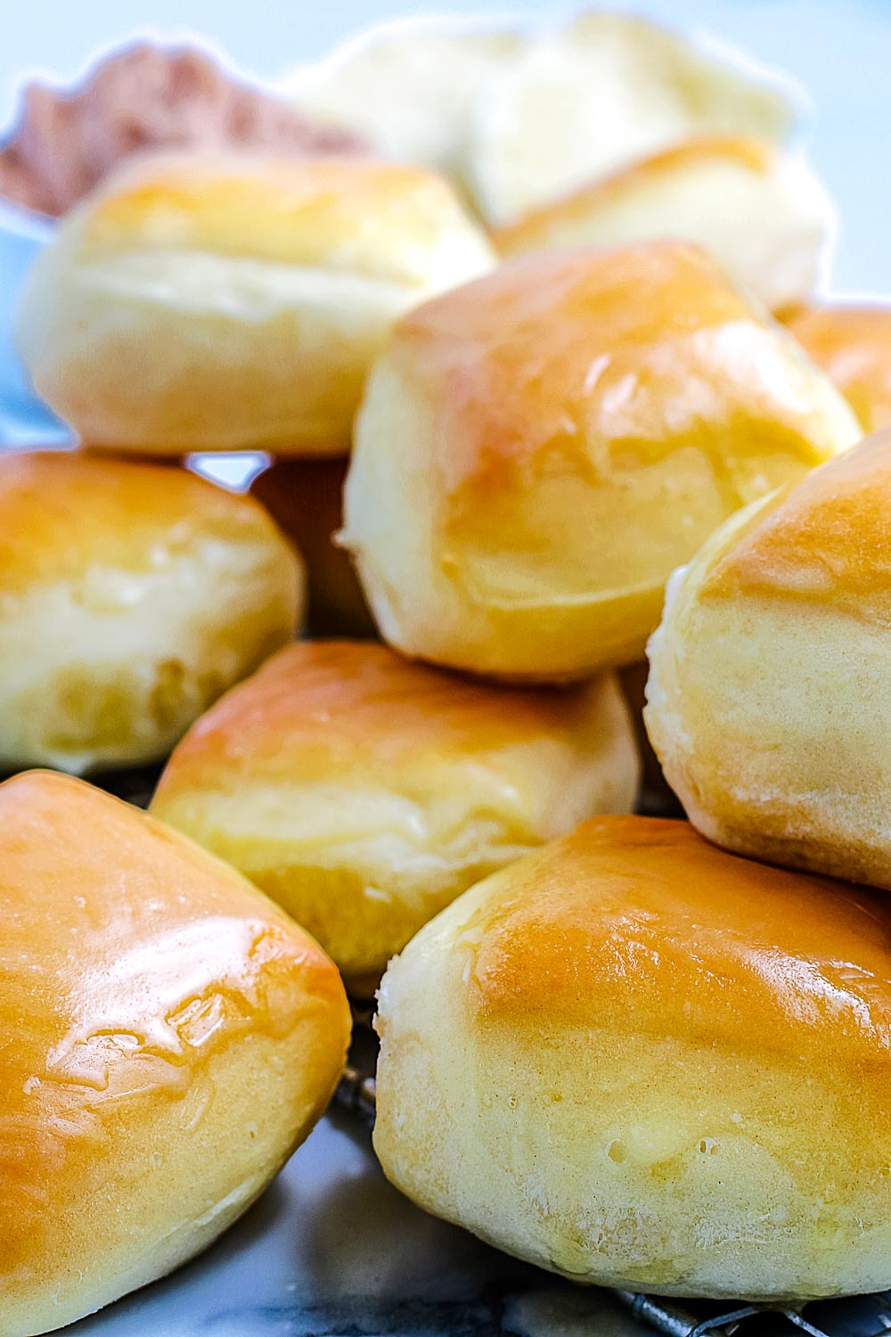 A close up picture of a pile of the finished Copycat Texas Roadhouse Rolls.