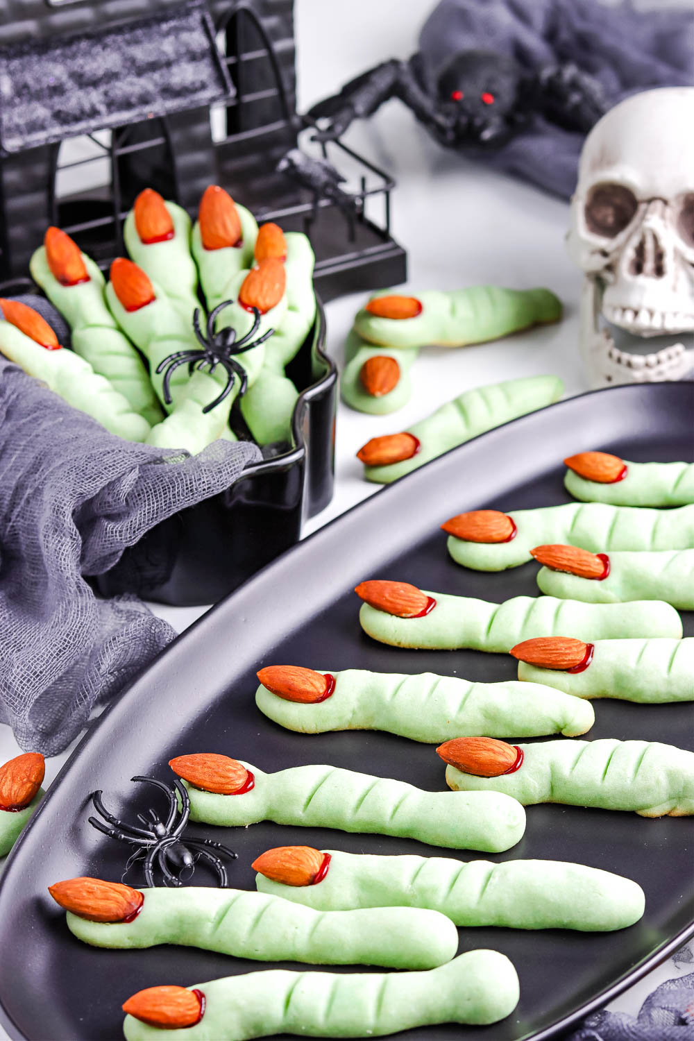 The finished Witch Finger Cookies on a black platter.