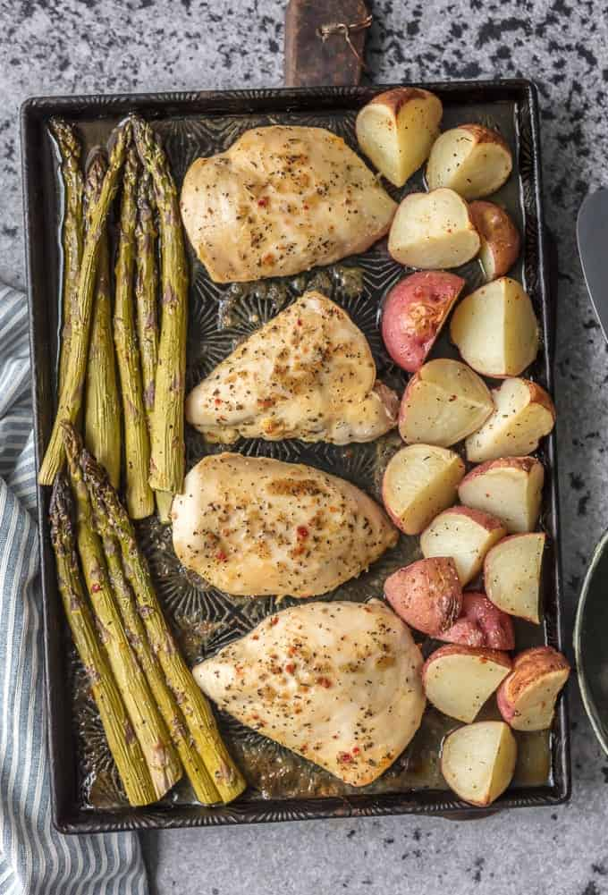 honey garlic chicken and vegetables with asparagus and potatoes in one pan