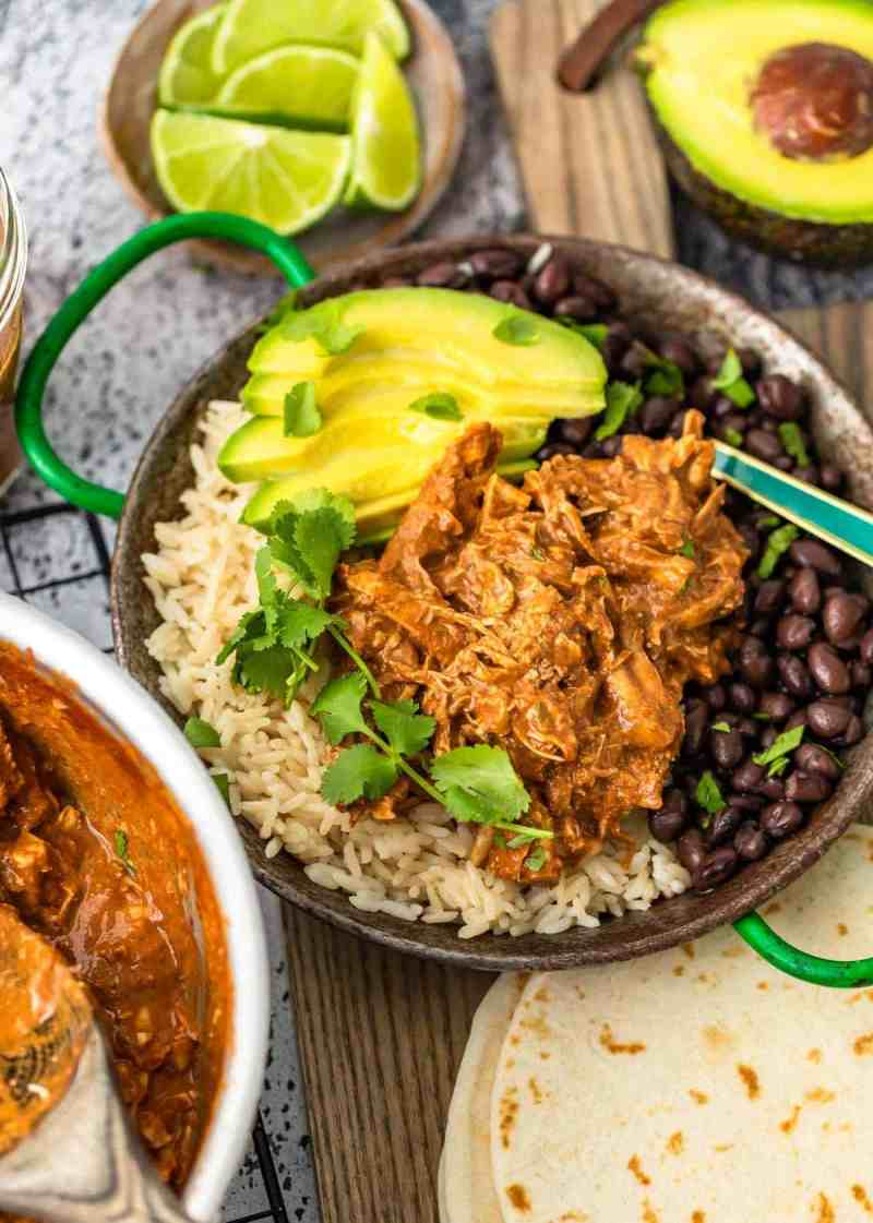 easy chicken mole with rice and black beans on plate