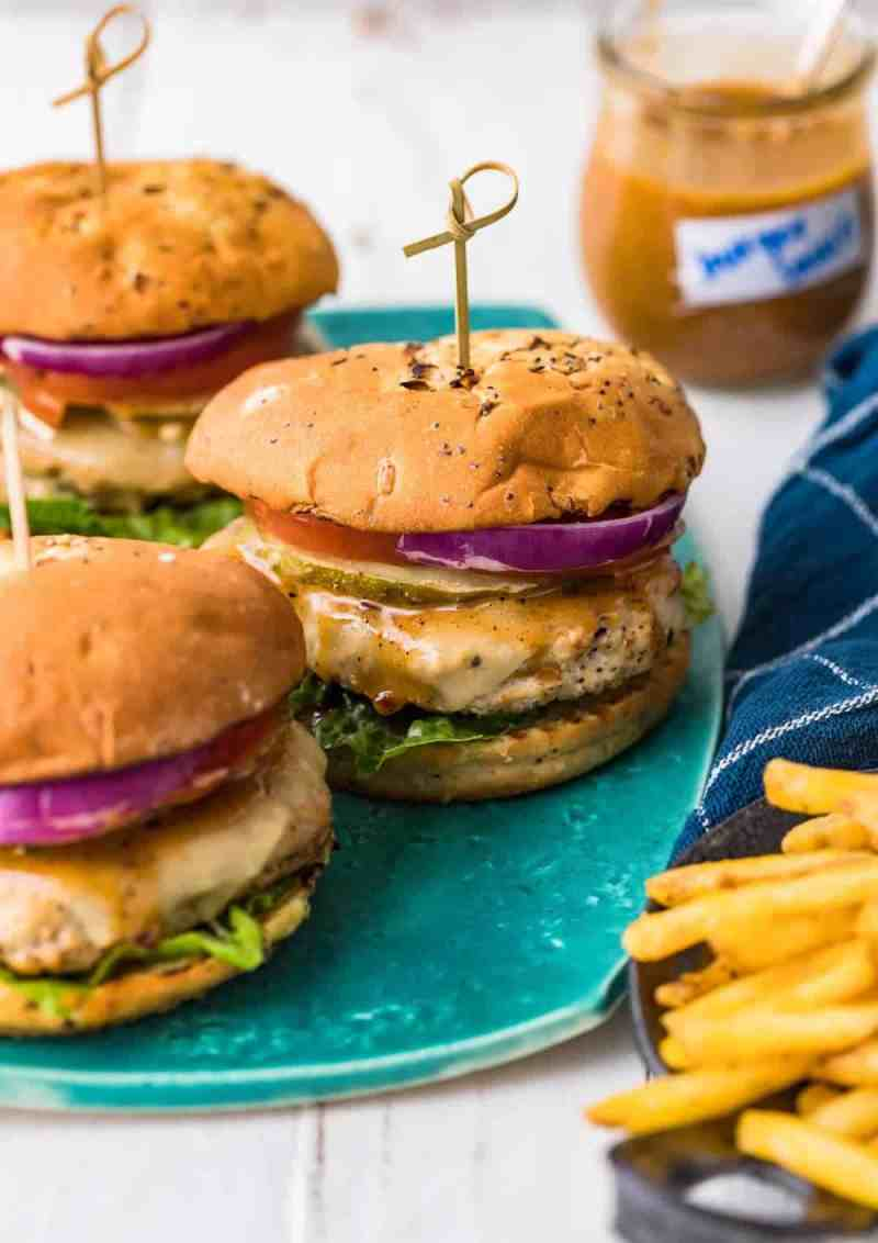 three juicy chicken burgers served with fries