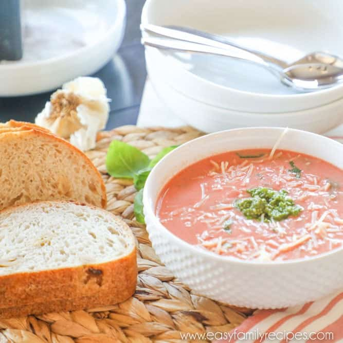 Slow Cooker Tomato Soup Garnished With Basil in Single Serving Bowl