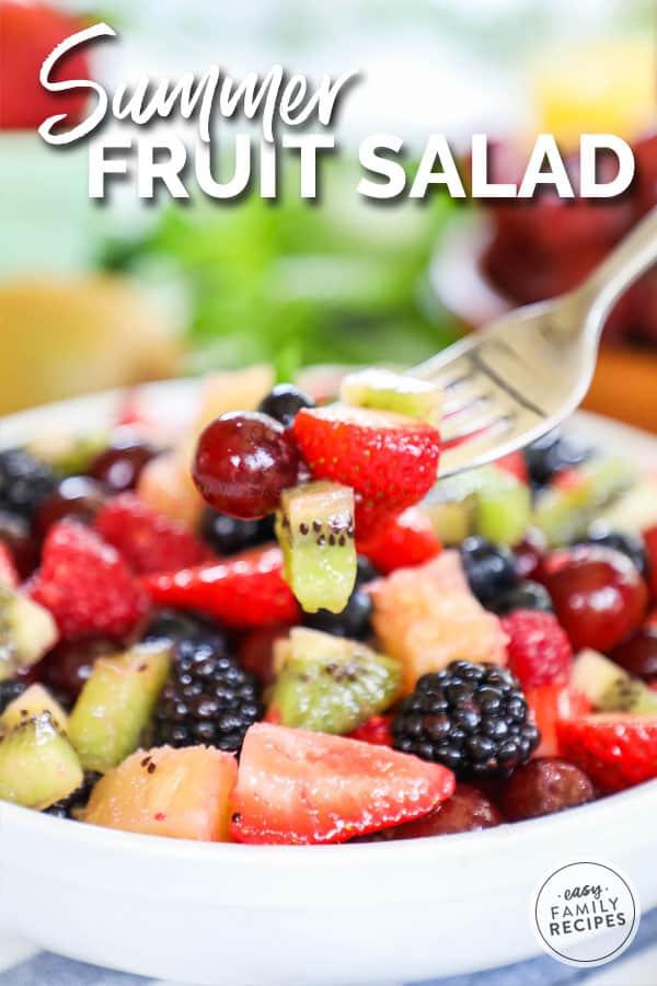 Fruit Salad on fork tossed with fruit salad dressing