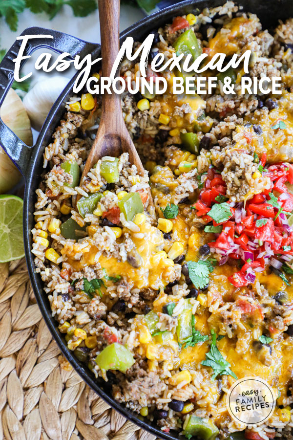 Getting a spoonful of Mexican Ground Beef and Rice from skillet