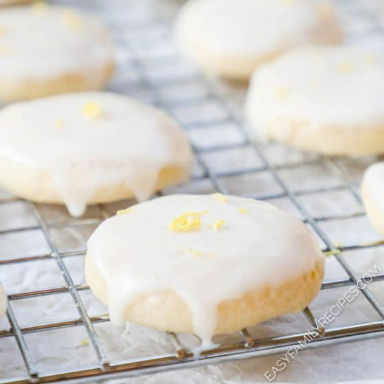 Lemon Meltaway Cookies with glaze on a cooling rack
