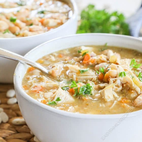 Leftover Turkey Bean soup in a bowl garnished with parsley