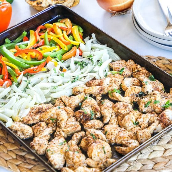 Chicken Fajitas with onions and bell peppers prepared on a sheet pan and ready to serve