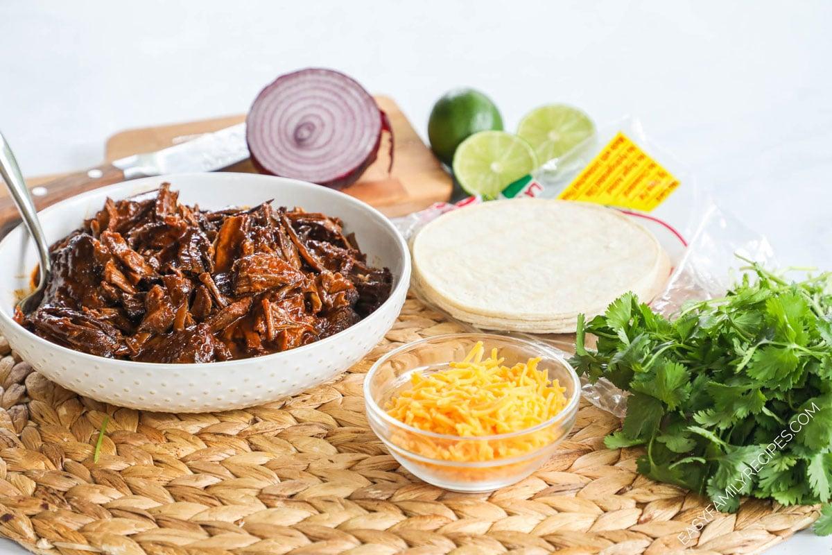 Ingredients for Brisket Taco Recipe - Leftover brisket, corn tortillas, cilantro, cheese, sour cream, pico de gallo
