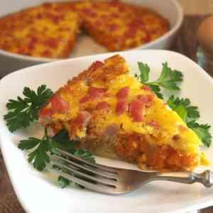 Sweet Potato Tot breakfast casserole wedge on plate
