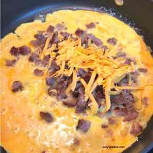 egg, cheese and sausage mixture in skillet