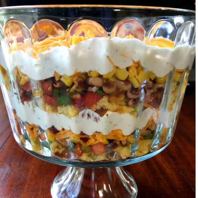 layers of cornbread salad in trifle bowl