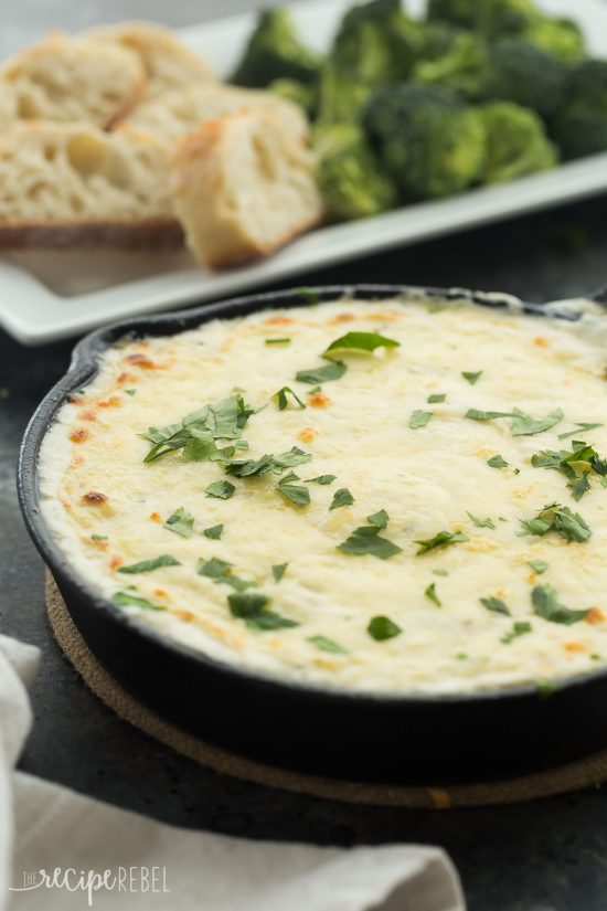 This Chicken Alfredo Dip is out of this world! It's creamy, cheesy, loaded with chicken and made from scratch! Perfect as an appetizer or a casual lunch or dinner.