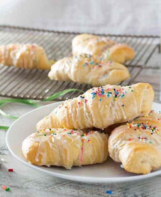Buttery crescent rolls filled with a funfetti cream cheese spread make these Funfetti Crescents aone of a kind dessert that is super easy to make, and FUN! Rich, buttery, sweet, colorful, and perfect for getting your kids into the kitchen to help!