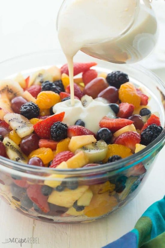 This Creamy Fruit Salad Recipe is made with a Homemade Vanilla Dressing —  It is the perfect summer breakfast, snack or dessert — use whatever fruit you have!