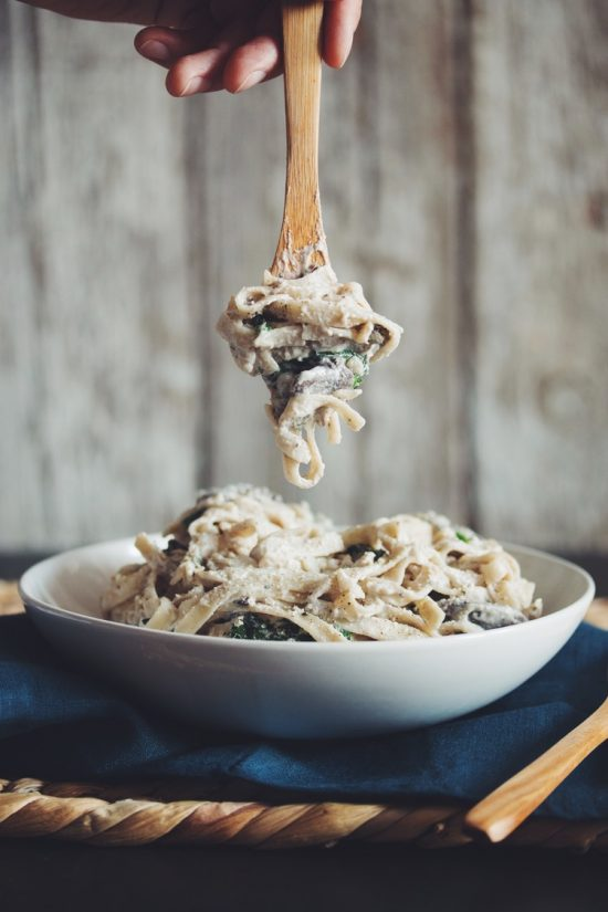 This Alfredo Pasta is guilt-free with a creamy vegan alfredo sauce made with cashews, white wine and the added punch of flavorful mushrooms!