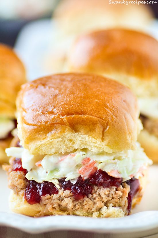 Pulled Pork Cranberry Slaw Sliders Succulent barbecue pulled pork seasoned to perfection and slow cooked for 8 hours, then topped on a toasted bun with cranberry sauce and coleslaw.