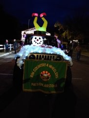 Christmas Parade The lead Jeep, pulling a trailer with elves working on a small Jeep in a makeshift garage. Made from scratch by our members. There were 9 additional Jeeps decorated behind the lead Jeep. Photographer: Garah Monnich