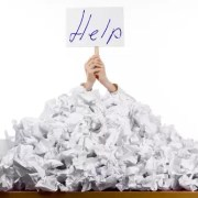 Overwhelmed Person Holding aHelp Sign