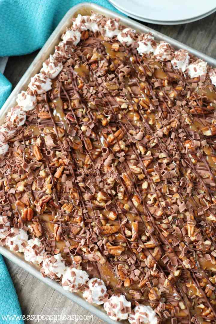 This Chocolate Turtle Slab Pie recipe is the perfect dessert to feed a crowd.