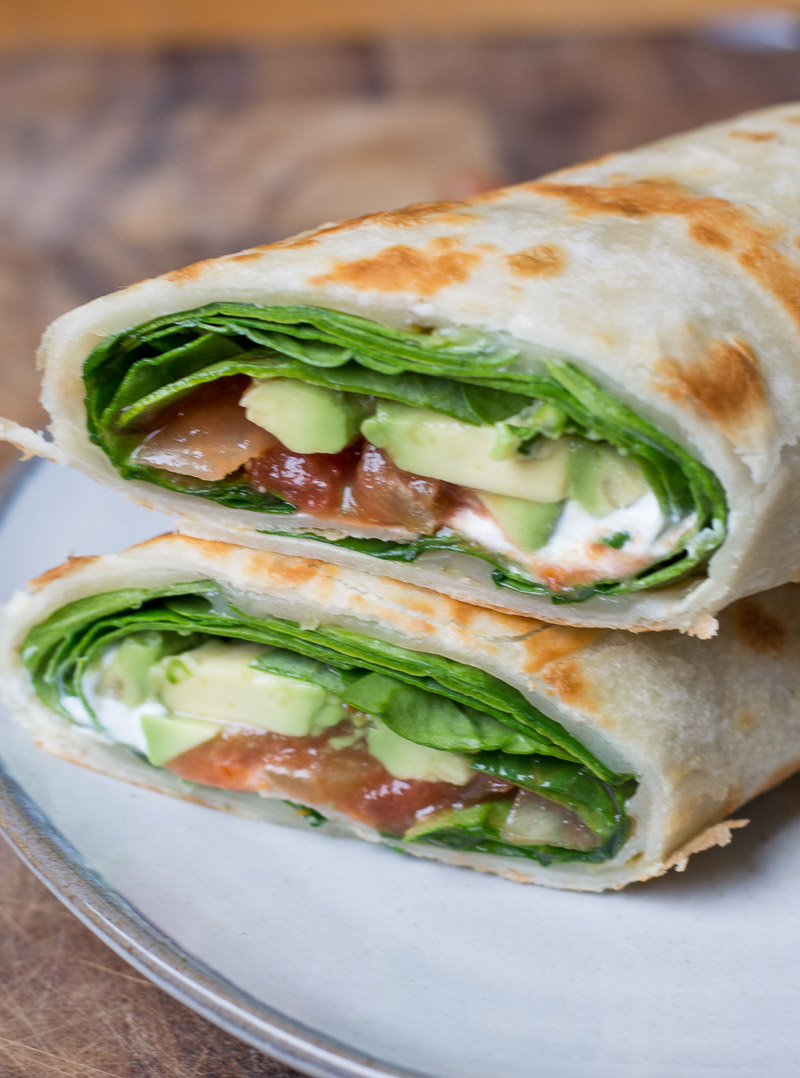 Need a quick and easy vegetarian dinner? This is the Best Spinach and Avocado Wrap loaded with spicy pepper jack cheese, fresh spinach, avocado and loaded with sour cream and salsa!
