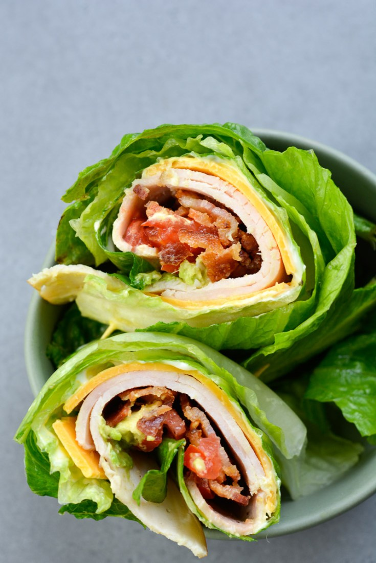This quick and easy Keto Turkey Club Wrap is loaded with deli turkey, salty bacon, crisp lettuce and tender avocado! The perfect low carb lunch recipe!