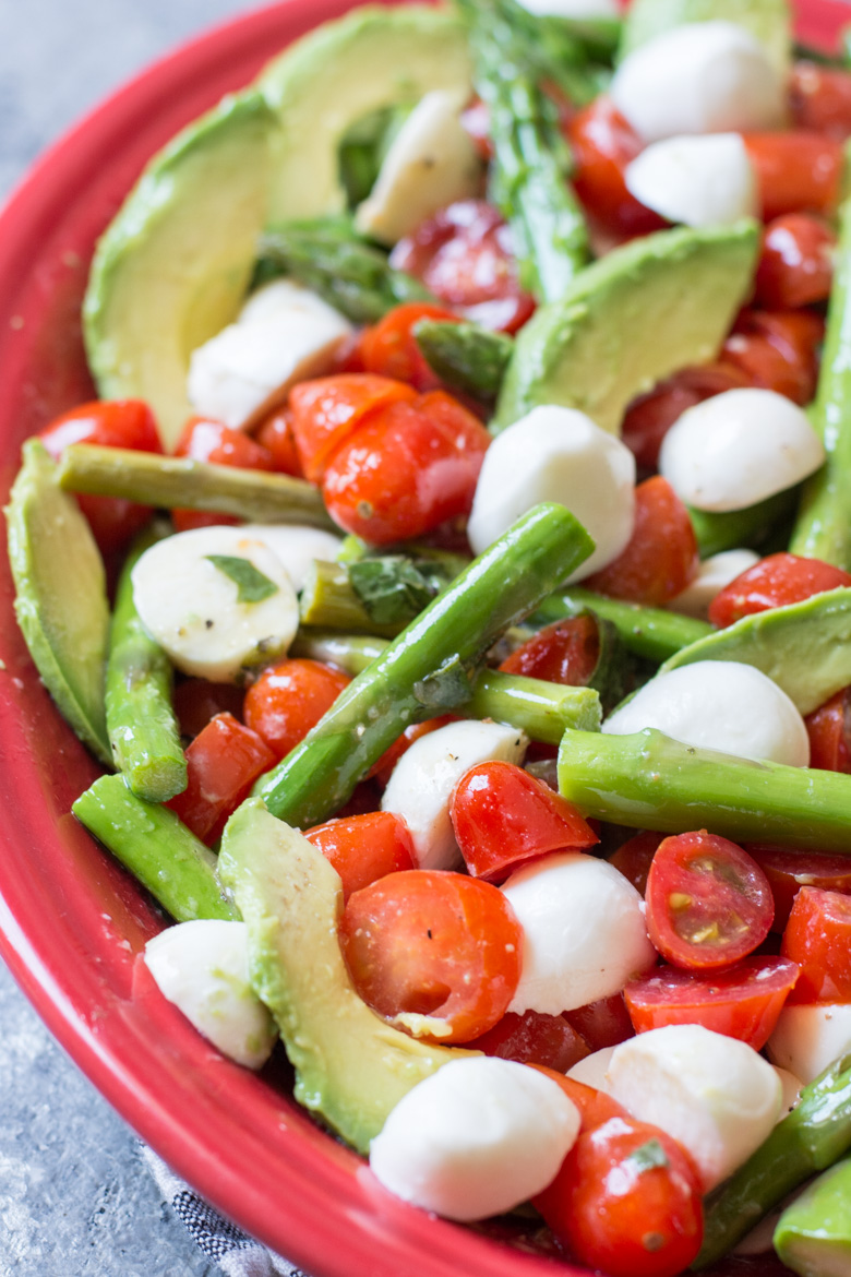 This Asparagus Caprese Salad is loaded with flavor and drizzled in a creamy lemon basil vinaigrette! This is the perfect low carb salad or side dish!