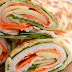 These easy Turkey Hummus Wraps come together in just a few minutes with basic ingredients like roast turkey, spinach, carrot, hummus and cheese! This is a quick and easy lunch recipe you will love!