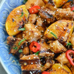 Asian Orange Chicken Bowls loaded with flavorful grilled chicken, sweet peppers and a grain of your choice! This is a great, healthy meal prep recipe!