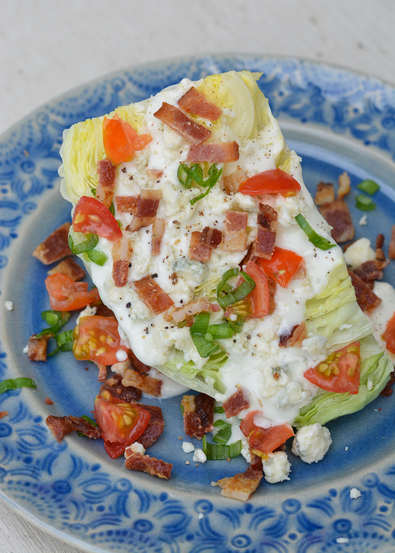 This Easy Wedge Salad is a simple low carb, keto-friendly side dish! Chilled iceberg lettuce is topped with tangy blue cheese, crispy bacon and tomatoes for a refreshing dish!