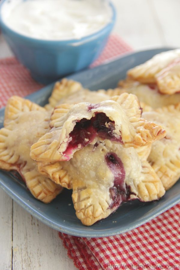 "Berry Mini Pies Dessert Recipe | Eat. Drink. Love. ""Enjoy your pie without utensils! These little pies are stuffed with fresh berries and are perfect for 4th of July parties!"""