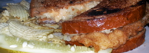 Breaded veal cutlet, Thousand Island, sauerkraut and swiss on grilled rye.