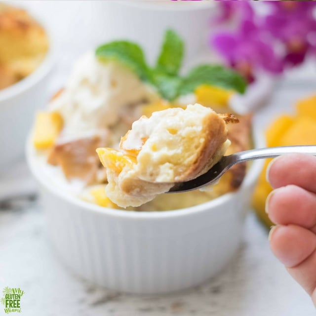 Close up of bite of gluten free mango bread pudding