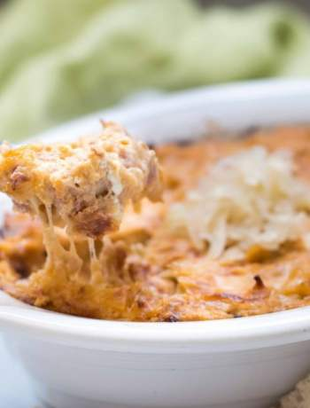 gluten free reuben dip being scooped out of a bowl
