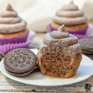 Gluten Free Cookies and Cream cupcake cut in half on plate