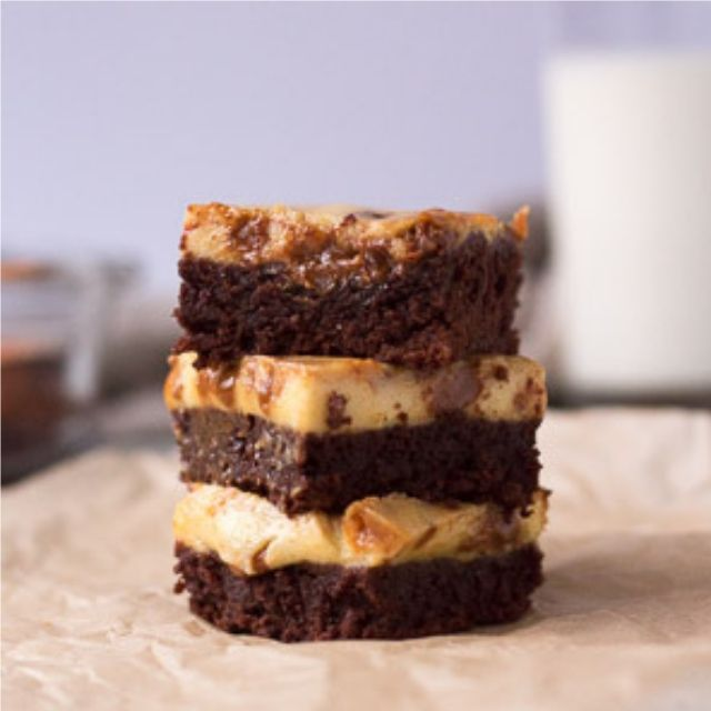 stack of dulce de leche cheesecake brownies
