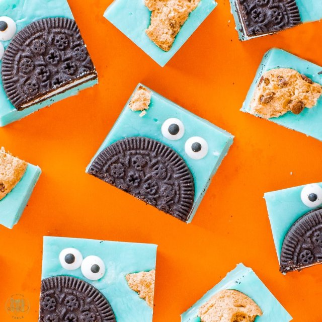 Cookie monster fudge cut into pieces on orange background.