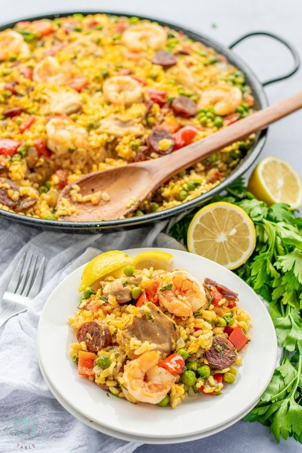 Plate of Gluten Free Paella Mixta with lemon and parsley