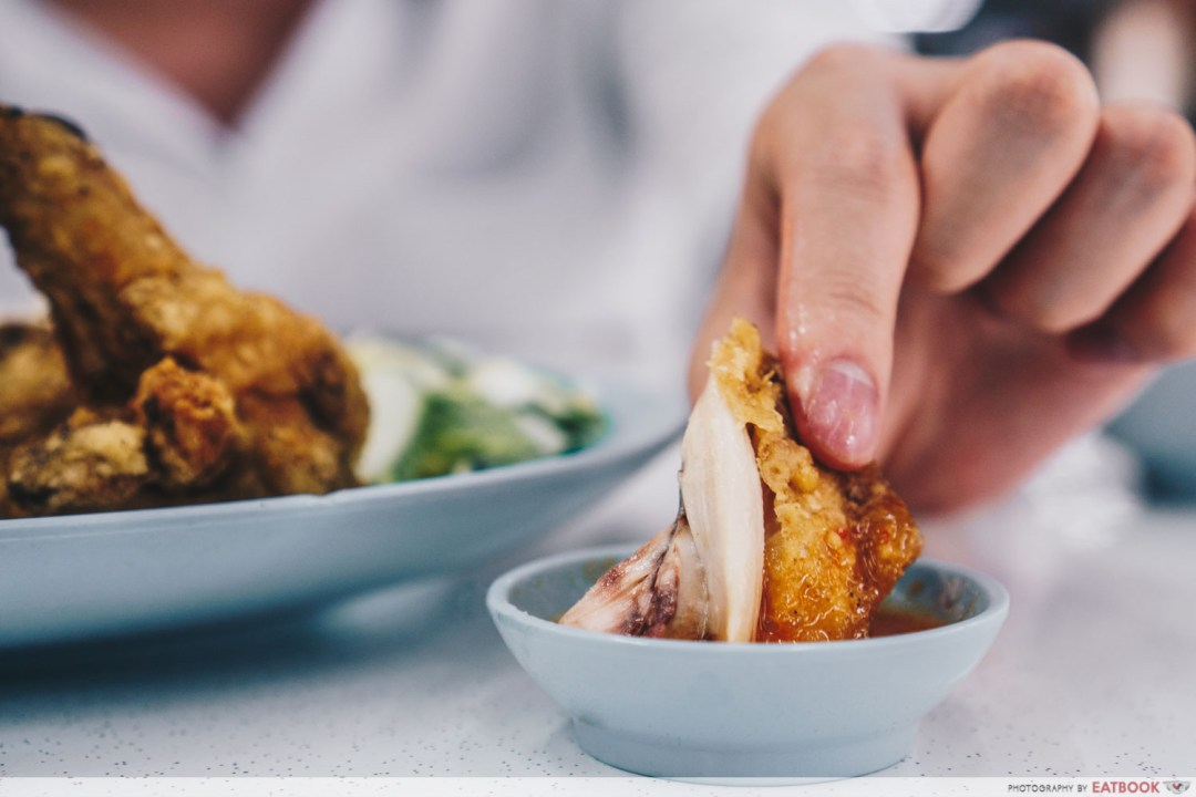 Victor Fried Chicken Wing RIce - dipping chicken in chilli
