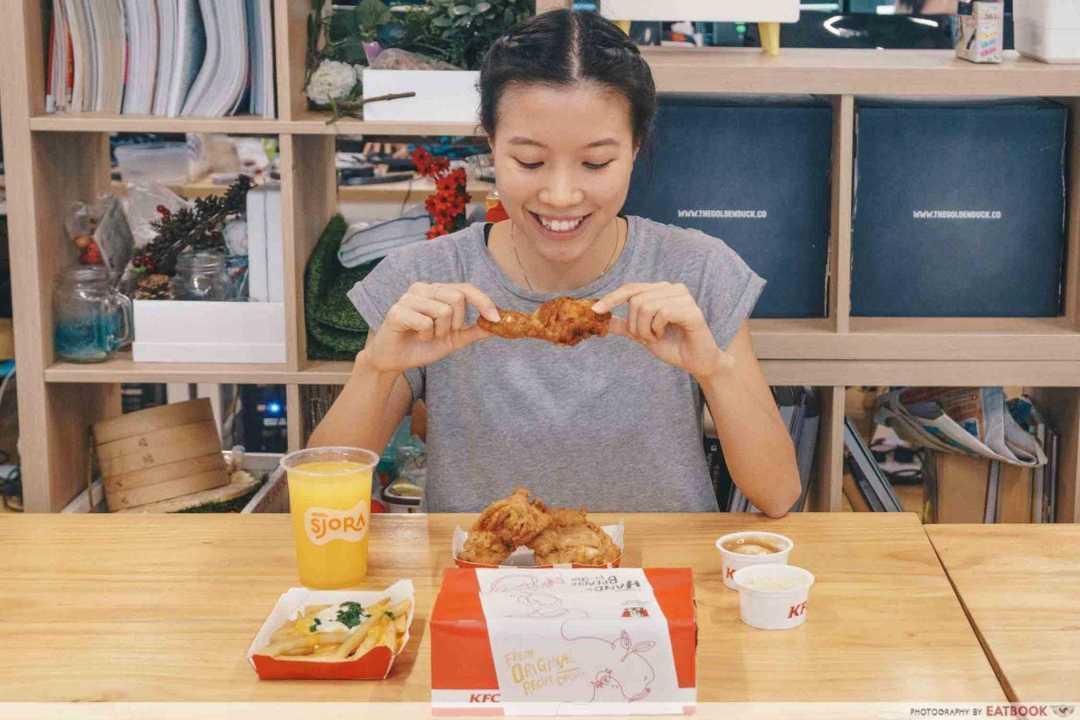 A girl eating KFC food