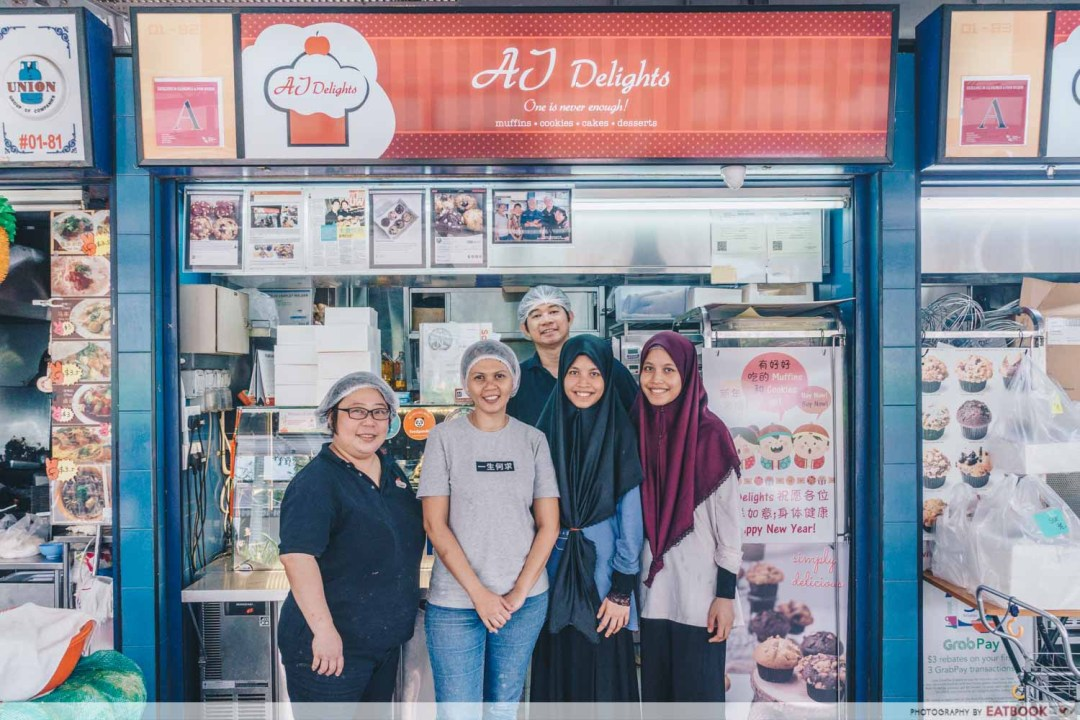 AJ Delights - Storefront shot with owners