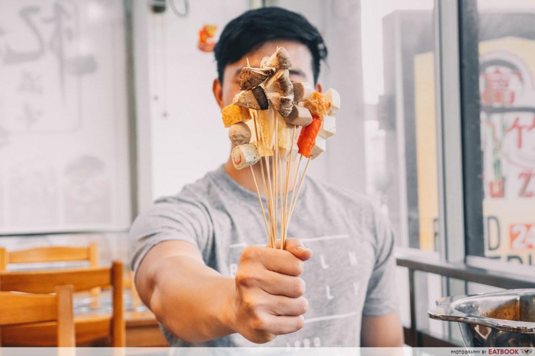 Yi Zi Wei - Holding up Lok Lok shot