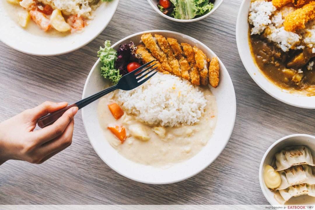 Kuroshiro - fried fish fillet white curry