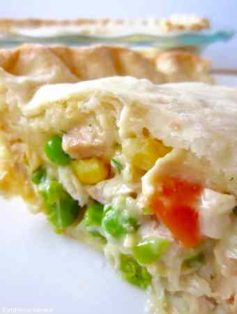 Easy Chicken Pot Pie is cheap, easy, and ready in under an hour. Filled with mixed veggies, creamy sauce, and a quick flaky pie crust!