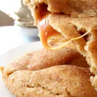 Caramel Stuffed Snickerdoodle recipe for a classic chewy cookie with a cinnamon sugar coating and to die for caramel filling.