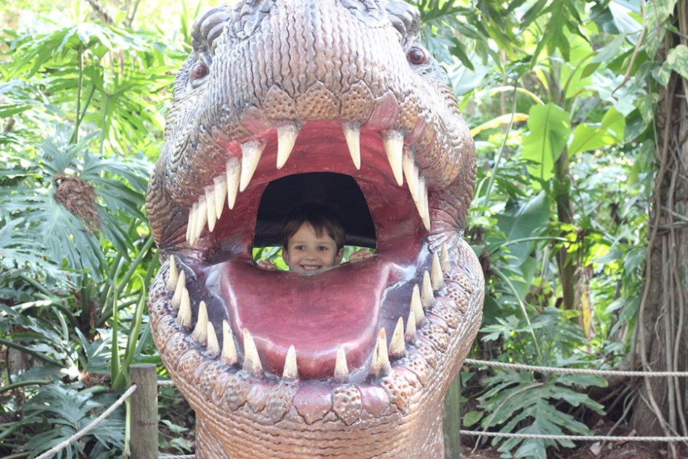 Robert getting eaten by a dinosaur at Dinosaur World